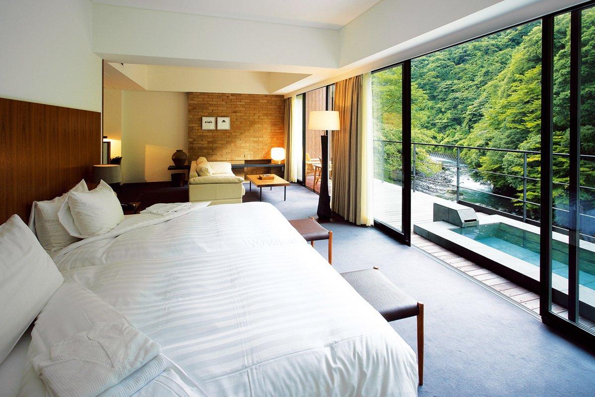 Bedroom, Floor Lighting, Bed, and Carpet Floor  Arcana Izu