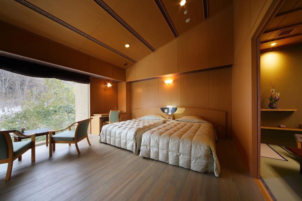 Bedroom, Bed, Ceiling Lighting, Chair, Wall Lighting, and Medium Hardwood Floor  Best Photos from Bettei Senjyuan