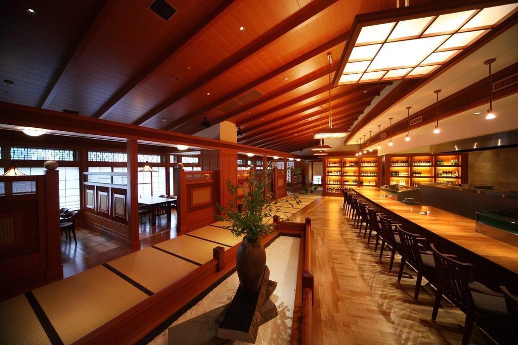 Dining Room, Table, Chair, Medium Hardwood Floor, and Pendant Lighting  Bettei Otozure