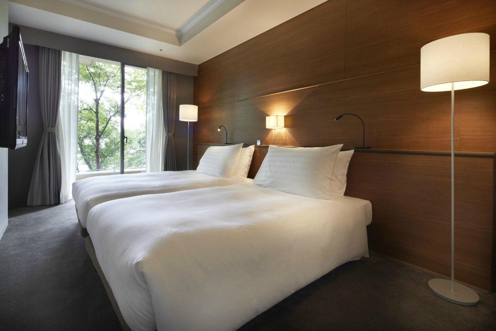 Bedroom, Carpet Floor, Bed, Floor Lighting, and Table Lighting  Best Photos from Agora Fukuoka Hilltop Hotel & Spa