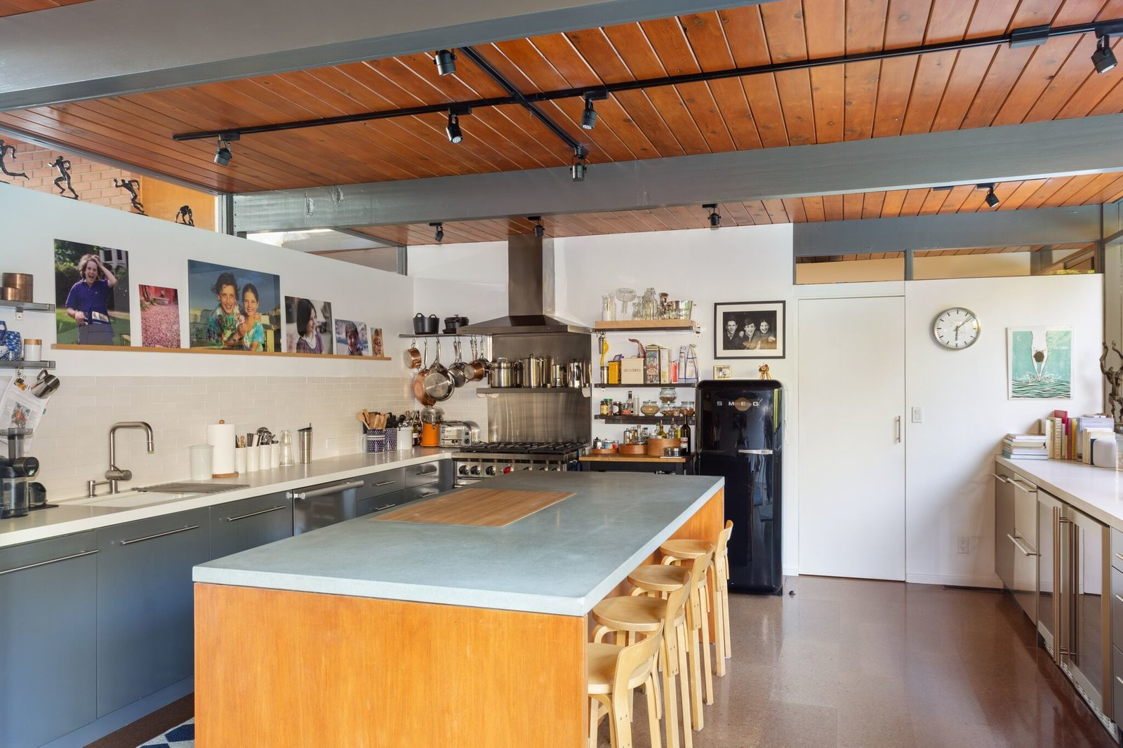 Kitchen, Range Hood, Track, Range, Refrigerator, and Undermount  Best Kitchen Track Undermount Refrigerator Photos from This Post-and-Beam in Pasadena Offers Classic California Living For $2M