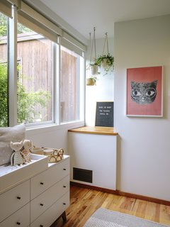 The 3,700-square-foot home has four bedrooms. The owners, who are expecting their first <br>child, just finished transforming one of them into a nursery. The dresser is from Room & Board and the hanging planters are by Sandbox Ceramics.