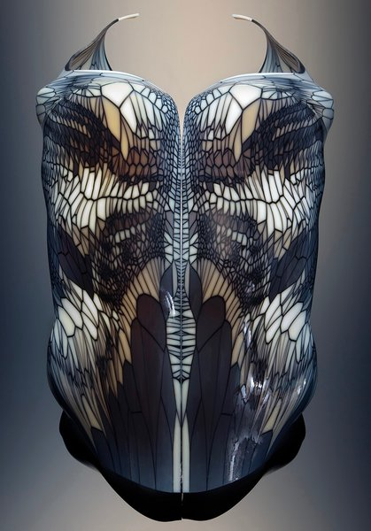 Inspired by the myth of Arachné, who was transformed into a spider by the goddess Athena, this 3D-printed, multimaterial corset, made in collaboration with Stratasys and W. Craig Carter and part of the permanent collection of MoMA, is imagined as a flexible armor optimized for both mechanical protection and flexibility.