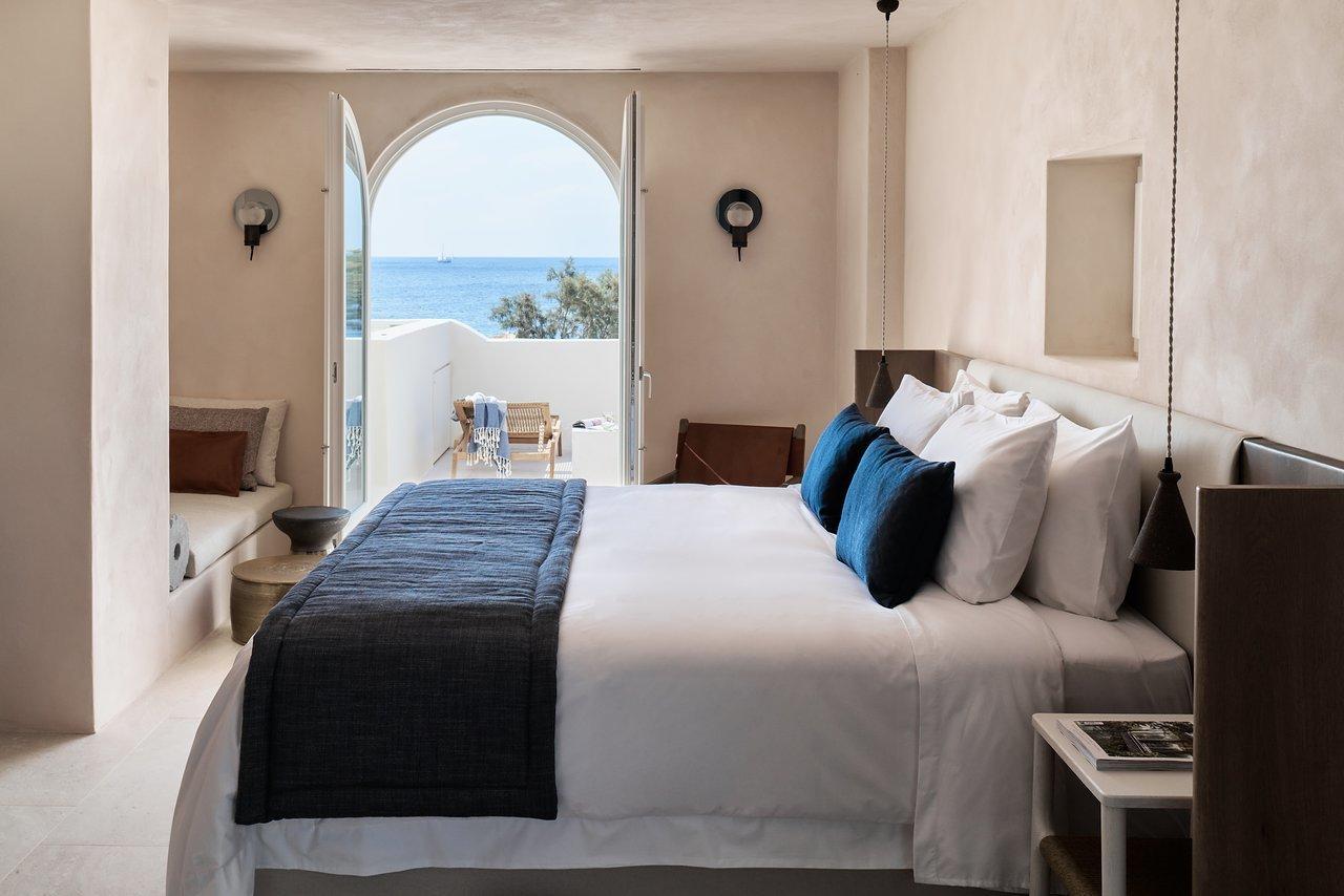 Bedroom, Bed, Night Stands, Wall Lighting, and Pendant Lighting  Istoria Hotel