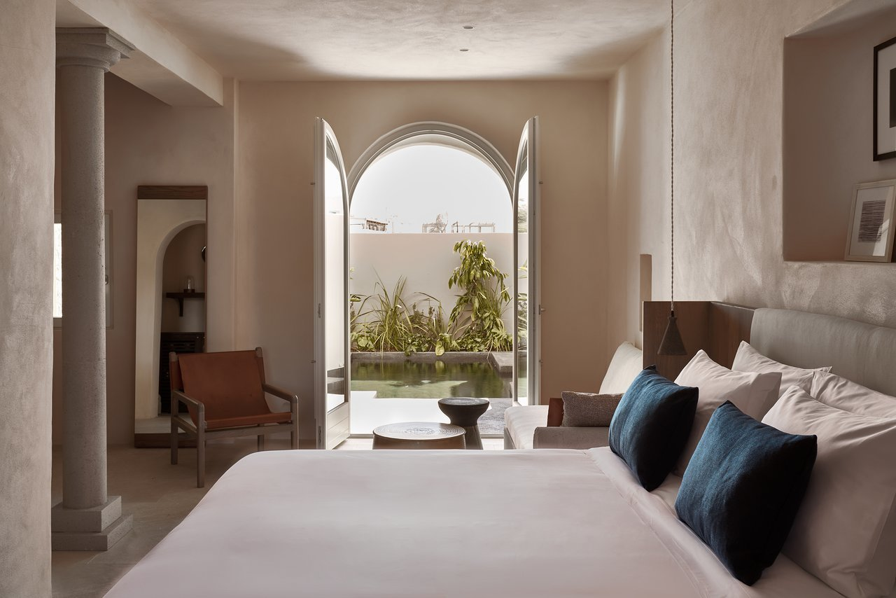 Bedroom, Pendant Lighting, Recessed Lighting, Chair, Bed, and Night Stands  Istoria Hotel