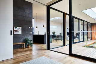 The floor-to-ceiling windows visually connect the entire house.
