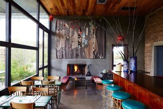The modern, Mexican-inspired interiors of Capri reflect its menu, with traditional rugs and warm wooden chairs contrasting with carefully selected modern artwork and a sleek bar.