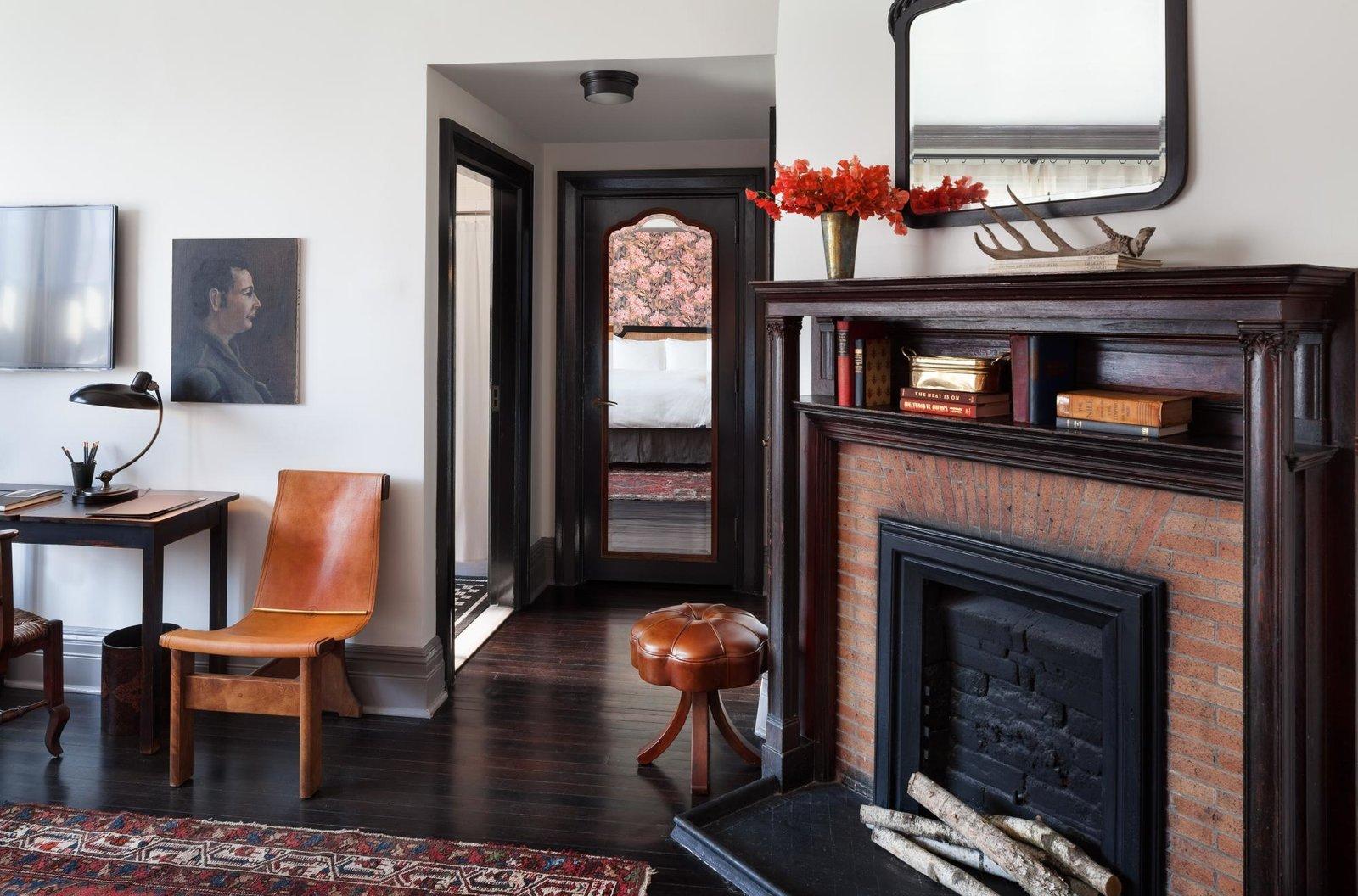 Living Room, Lamps, Dark Hardwood Floor, Table Lighting, Rug Floor, Desk, Chair, Stools, and Corner Fireplace  The High Line Hotel