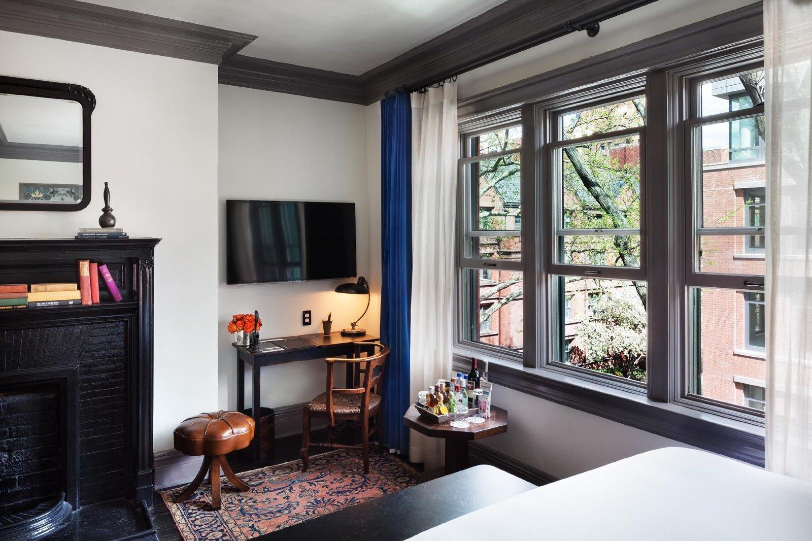 Bedroom, Rug Floor, Bed, Dark Hardwood Floor, Table Lighting, and Chair  The High Line Hotel