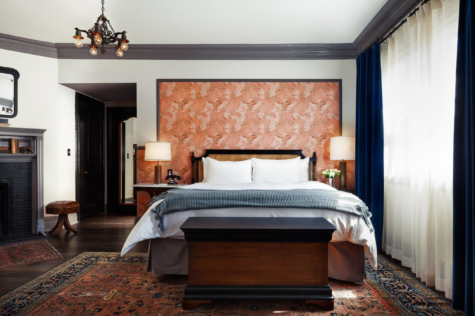 Bedroom, Bed, Pendant Lighting, Night Stands, Rug Floor, Dark Hardwood Floor, and Table Lighting  The High Line Hotel