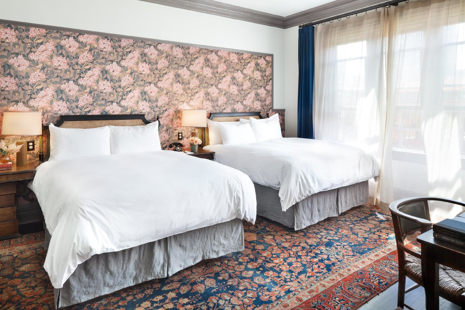 Bedroom, Rug Floor, Bed, Table Lighting, Chair, Dark Hardwood Floor, and Night Stands  The High Line Hotel