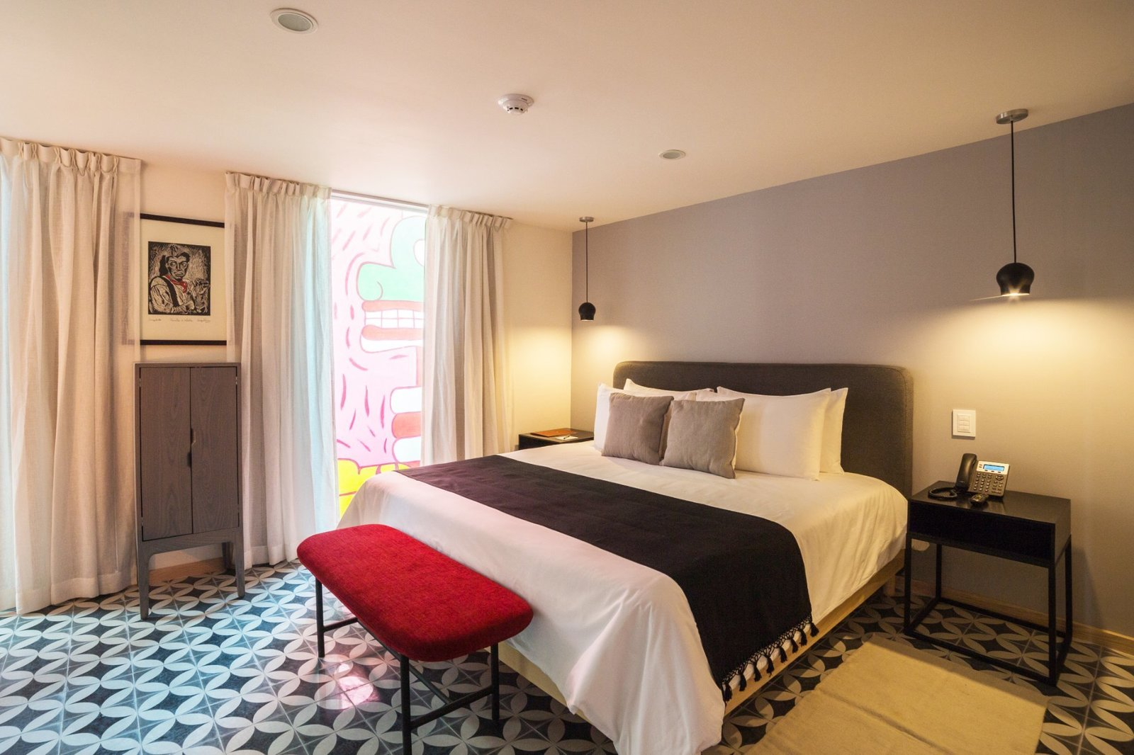 Bedroom, Night Stands, Bench, Recessed Lighting, Ceramic Tile Floor, Bed, and Storage  Hotel Morgana