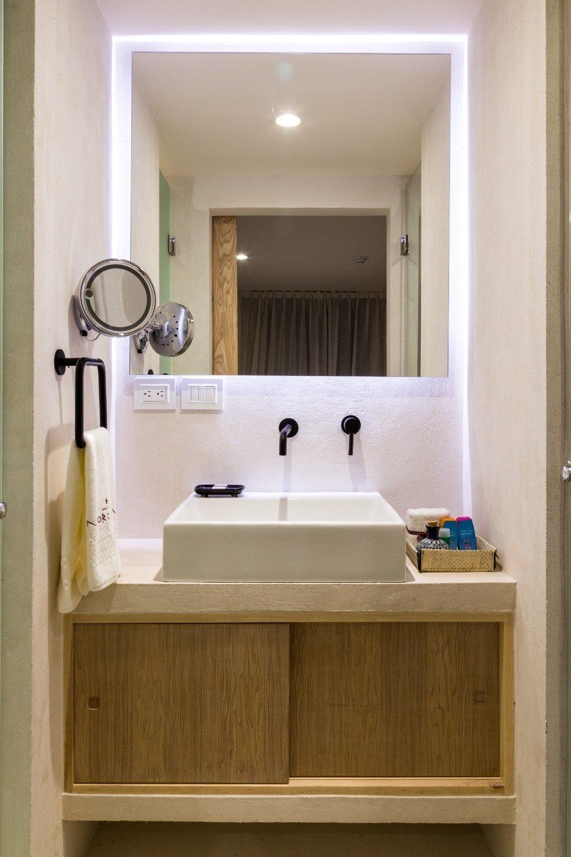 Bath Room, Recessed Lighting, Vessel Sink, Stone Slab Wall, Stone Counter, and Limestone Floor  Hotel Morgana