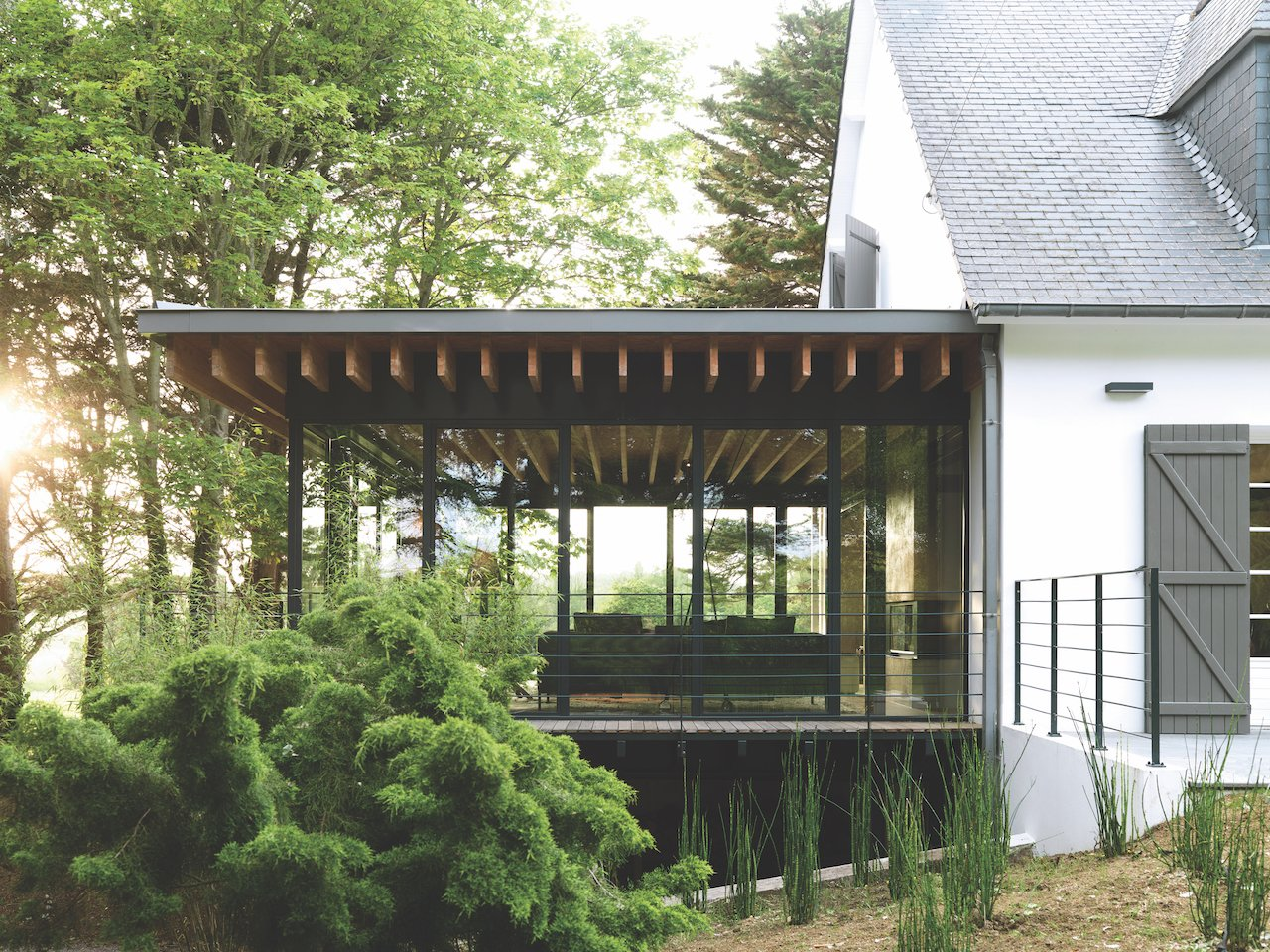 A Stone Retreat in France Gets a Sleek Glass Addition