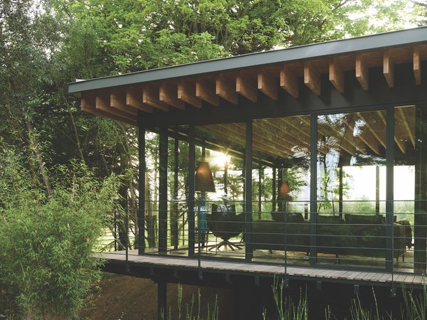 The glass-and-steel extension allows the homeowners to embed themselves in the natural environment.