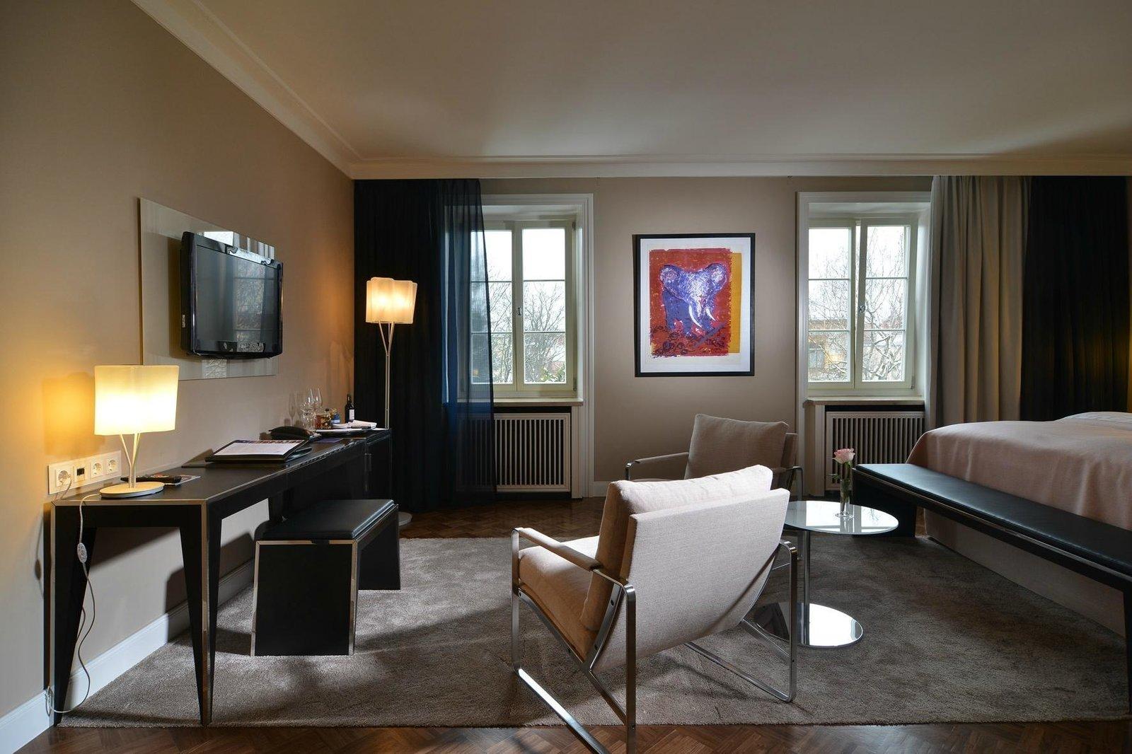Bedroom, Floor Lighting, Medium Hardwood Floor, Rug Floor, Bed, and Chair  Hotel Elephant