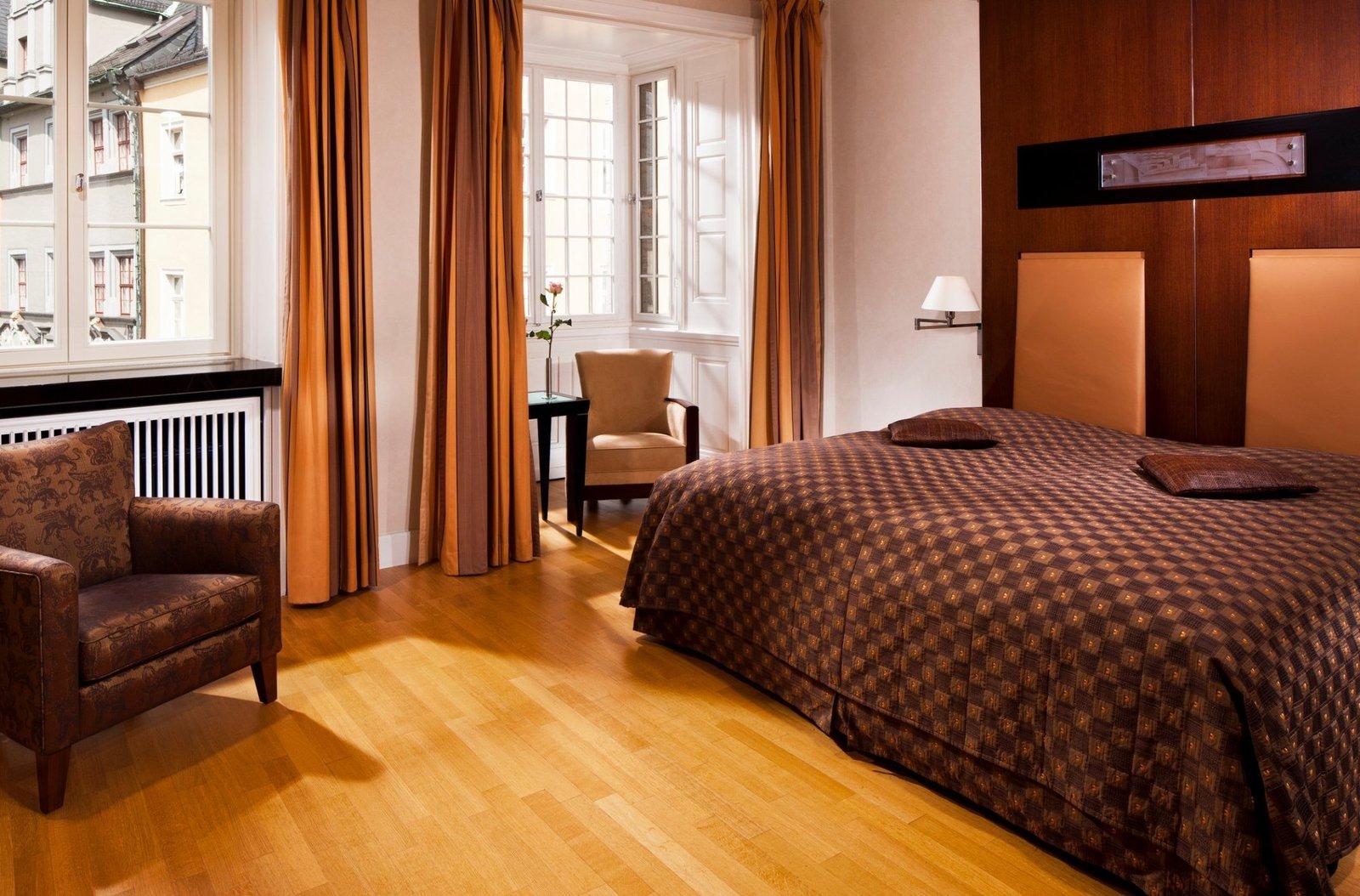 Bedroom, Wall Lighting, Chair, Bed, and Medium Hardwood Floor  Hotel Elephant
