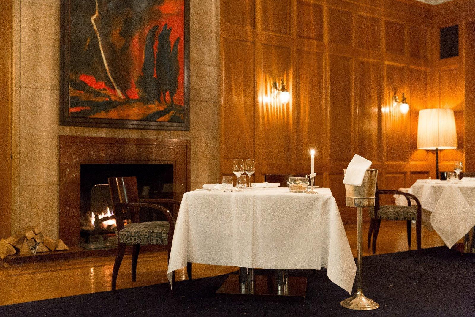 Dining Room, Standard Layout Fireplace, Wall Lighting, Floor Lighting, Rug Floor, Chair, Table, and Medium Hardwood Floor  Hotel Elephant
