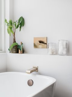 The tub has a tap by Delta Faucet.