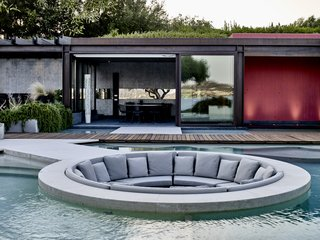 The swanky mid-pool conversation pit was added by the new owners during the renovation.