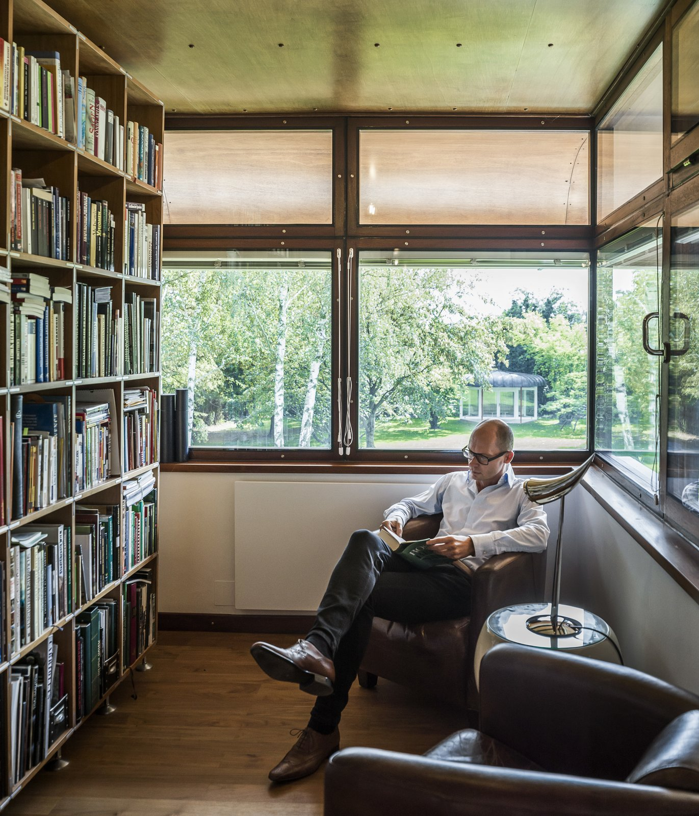Office, Library, Shelves, Chair, and Light Hardwood  Best Office Library Shelves Photos from An Austrian Family Embraces a Plush 1970s Home in Need of a Little Love