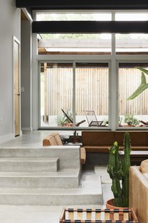 The sunken living room features a built-in sofa and loveseat.
