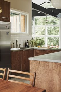 To save money, many of the windows Bob chose are not operable. The window above the kitchen sink is an exception. The refrigerator is by Whirlpool.