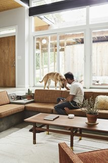 The rug in the sunken living room is from West Elm.