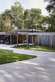 The post-and-beam frame extends beyond the home's envelope.