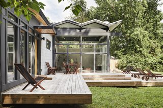 An energy-efficient TPO membrane covers the living room's zigzag roof.