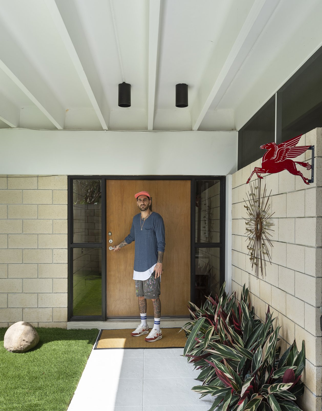 Doors, Exterior, and Wood  Photo 14 of 25 in Pop Art, Street Art, and Space Age Furniture Collide at a Painter's Midcentury Ranch Home in Florida