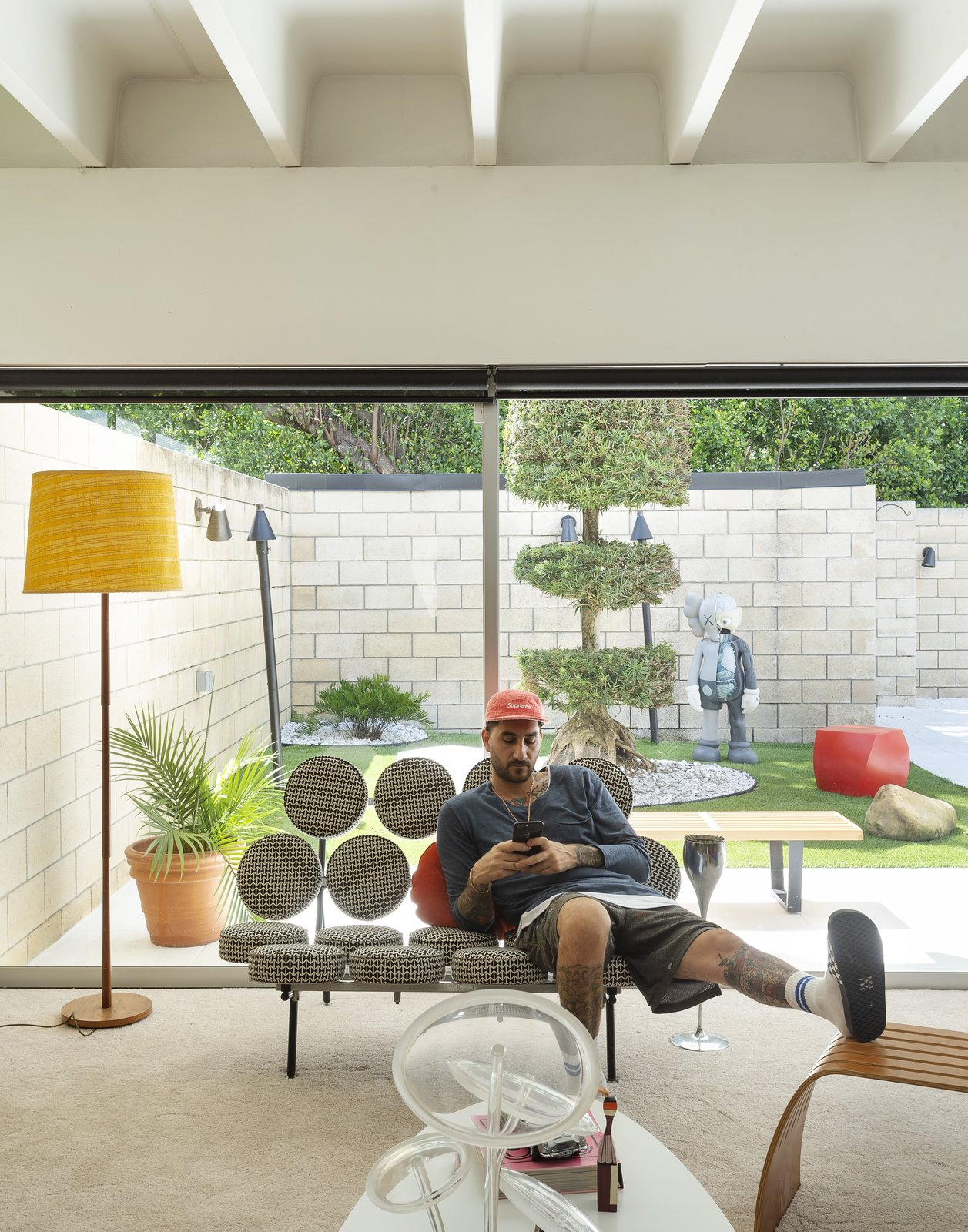 Living Room, Chair, Carpet Floor, Sofa, Coffee Tables, and Floor Lighting  The Ellison House from Pop Art, Street Art, and Space-Age Furniture Collide at a Painter's Midcentury Ranch Home in Florida