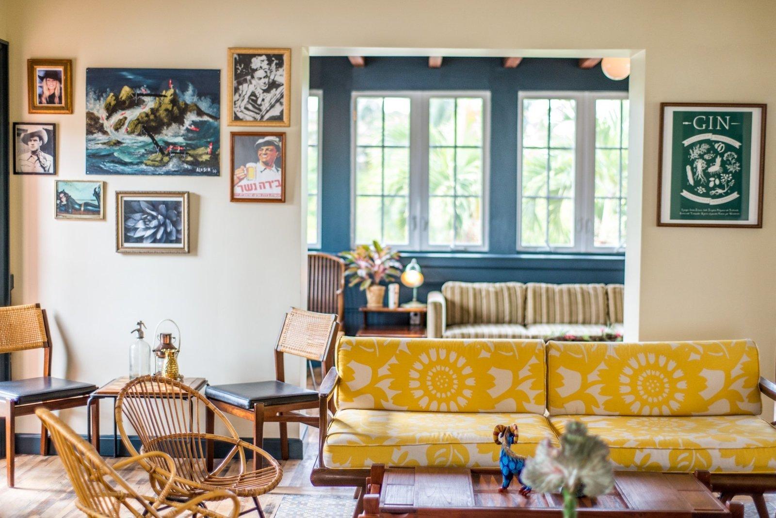 Living Room, Sofa, Coffee Tables, Medium Hardwood Floor, End Tables, Rug Floor, Chair, and Table Lighting  Miami Freehand