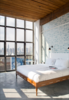 Modern home with Bedroom, Wall Lighting, Bed, and Chair. Photo 11 of Wythe Hotel