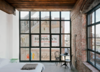 Modern home with Bedroom, Concrete Floor, Night Stands, Chair, and Bed. Photo 12 of Wythe Hotel