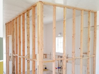 Framing for the new bedroom takes the place of the old kitchen.