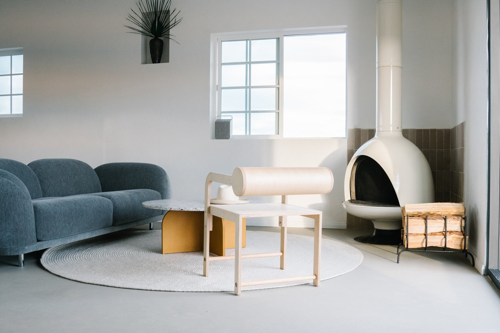 Living Room, Concrete Floor, Sofa, Coffee Tables, and Hanging Fireplace  Casa Mami