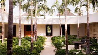 This Tropical Mexican Home Wraps Around a Lush Garden