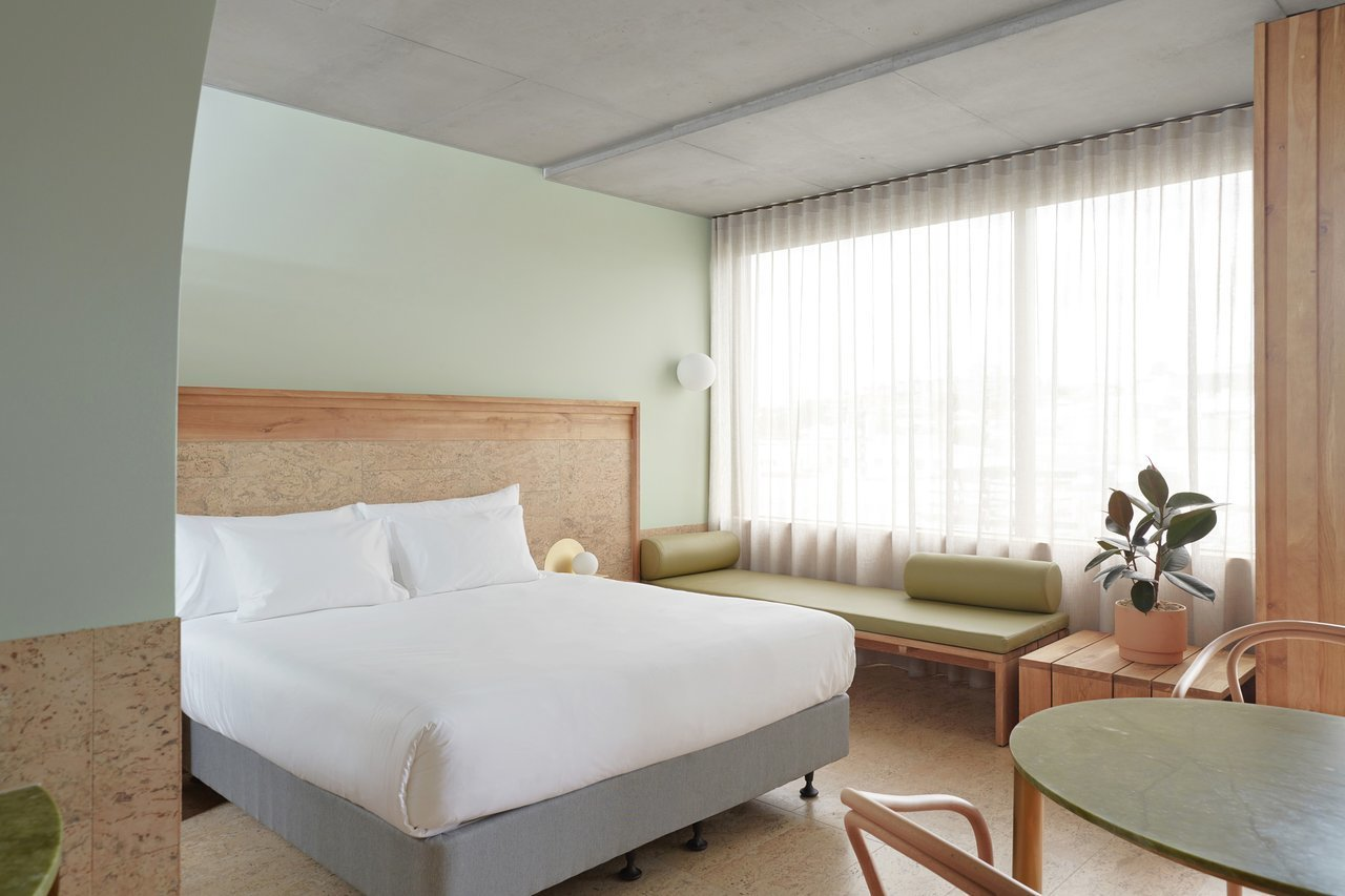 Bedroom, Bench, Chair, Night Stands, Table Lighting, Wall Lighting, and Bed  The Calile Hotel