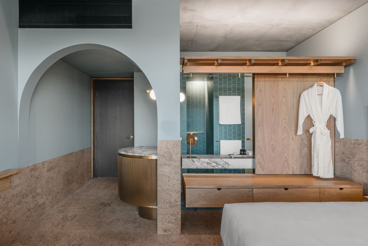 Bedroom, Wall Lighting, and Bed  The Calile Hotel