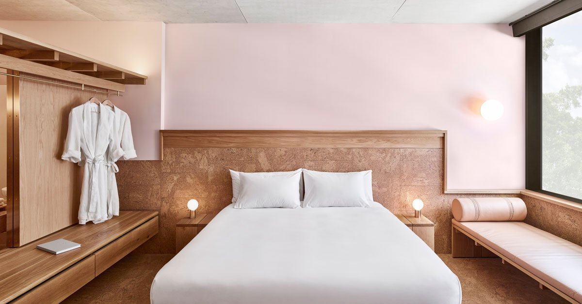 Bedroom, Night Stands, Bench, Table Lighting, Wall Lighting, and Bed  The Calile Hotel