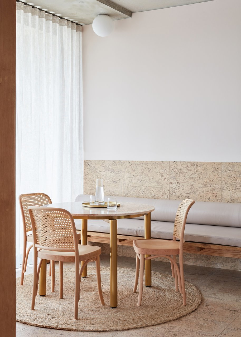Dining Room, Bench, Ceiling Lighting, Chair, Rug Floor, and Table  The Calile Hotel