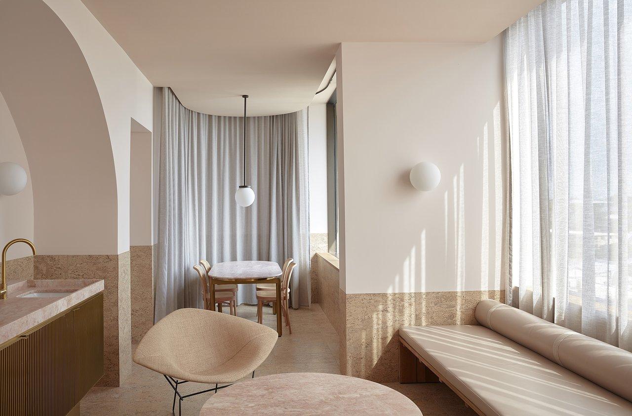 Living Room, Bench, Wall Lighting, Pendant Lighting, and Chair  The Calile Hotel