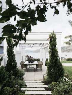 A pergola over the dining area allows for privacy without obstructing the phenomenal views.