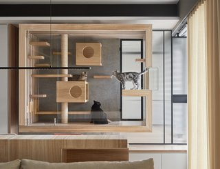 Indot, an interior design firm in Taiwan, designed this suspended enclosure for a client's four cats. The wood frame and interior elements of the cat house mesh with the rest of the home's interior finishes, while the glass ensures the installation doesn't convey too much visual weight.