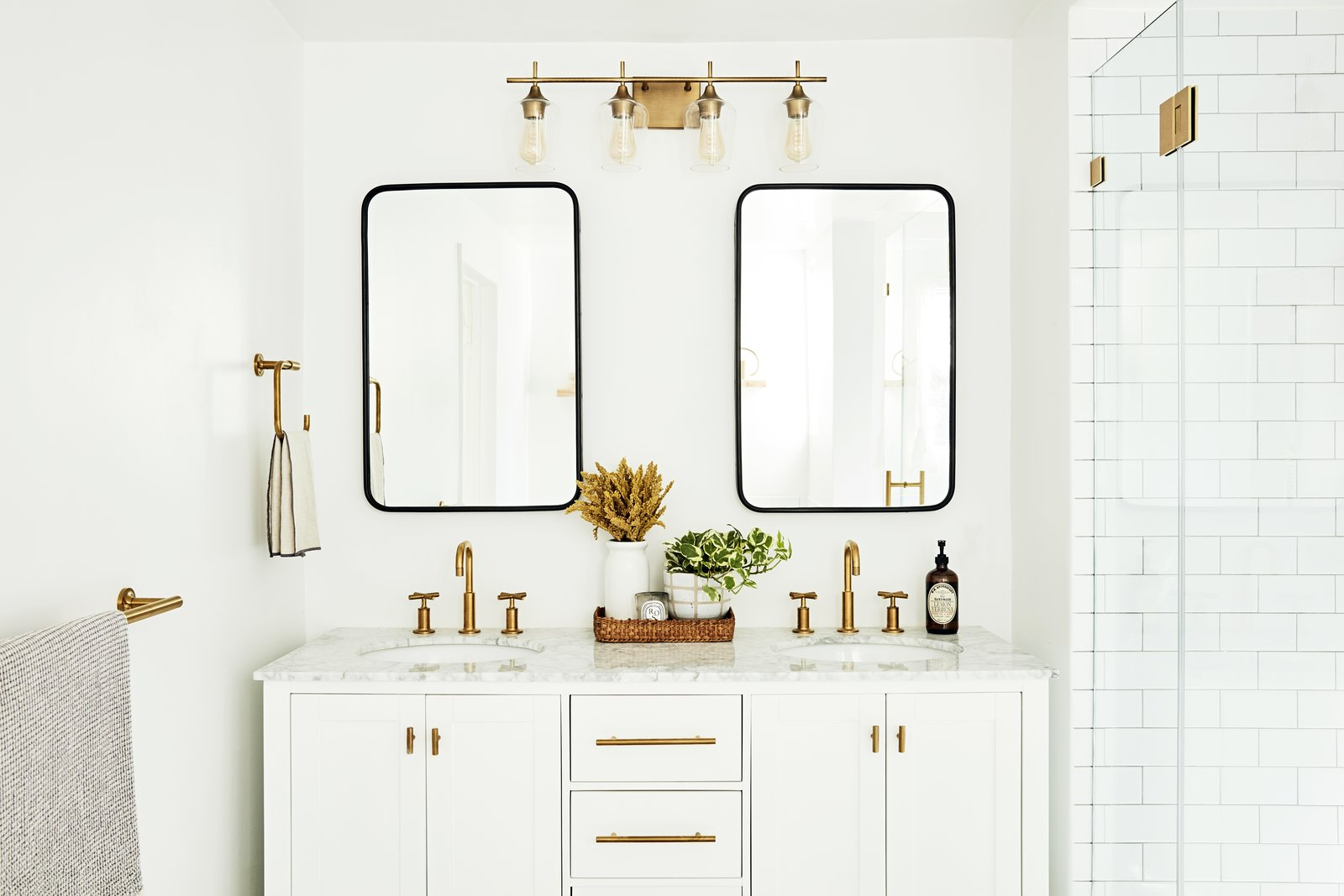 Bath, Undermount, Marble, Wall, Subway Tile, and Enclosed  Best Bath Enclosed Wall Photos from Bathrooms We Love: Beauty and Home Vlogger Kristin Johns Showcases Her Glistening Bathroom in LA