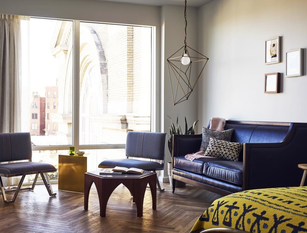 Living Room, End Tables, Dark Hardwood Floor, Sofa, Coffee Tables, Chair, and Pendant Lighting  Best Photos from The LINE DC