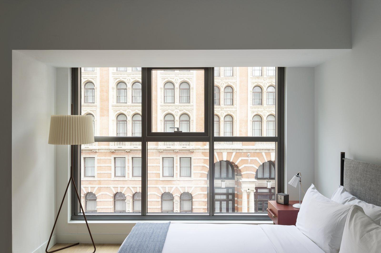 Bedroom, Floor Lighting, Bed, Night Stands, Lamps, and Light Hardwood Floor  ROOST Apartment Hotel