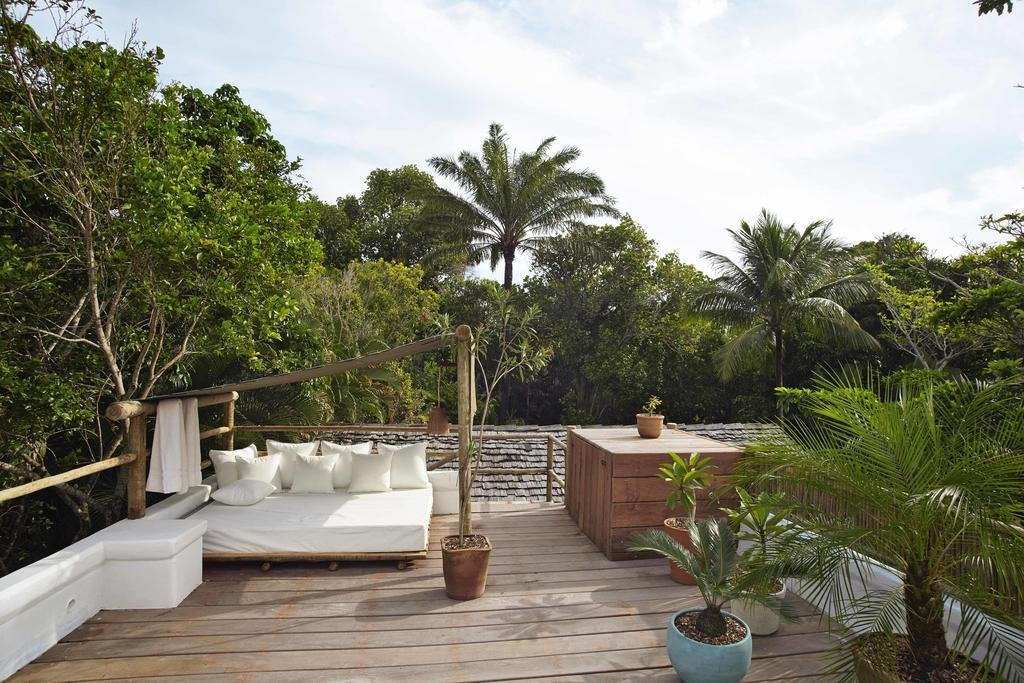 Outdoor, Wood Patio, Porch, Deck, Rooftop, and Trees  UXUA Casa Hotel & Spa