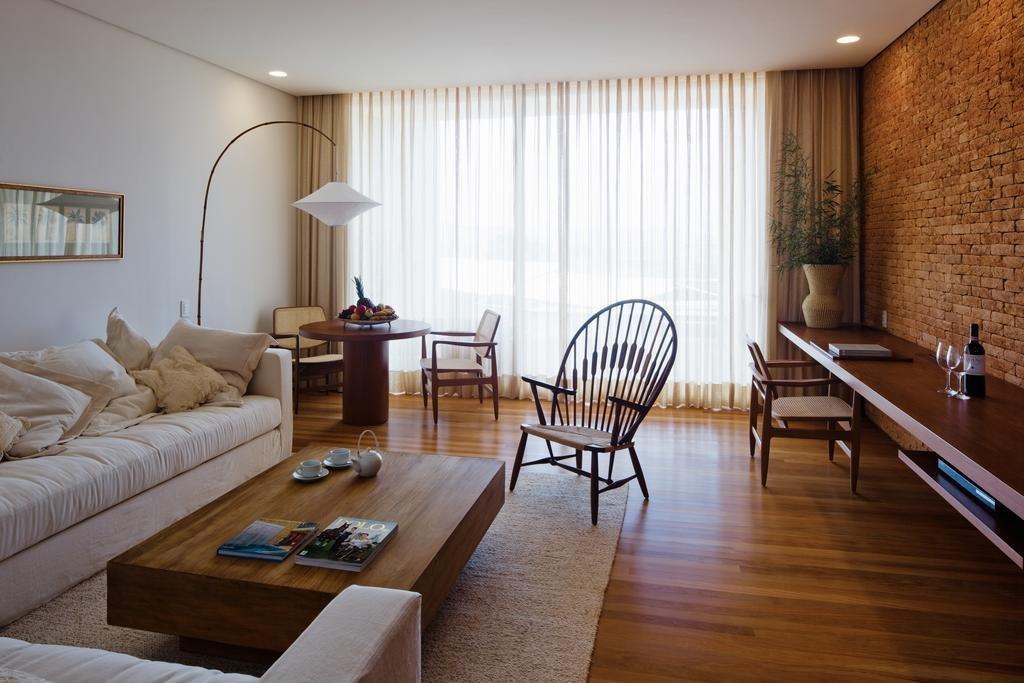 Living Room, Chair, Desk, Coffee Tables, Rug Floor, Medium Hardwood Floor, Floor Lighting, Table, Recessed Lighting, and Sectional  Fasano Boa Vista